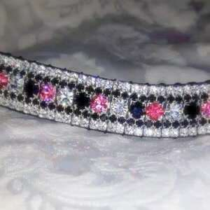 amazBling Colour Pro pink browbands with Rose, Jet and Clear Preciosa crystals. PonyCouture specialize in quality, handmade Crystal Browbands and this Pink Browband is no exception to the rule! Sedgwick English leather and Preciosa crystals are handmade into this selection of stunning pink bling browbands. Ideal for the dressage ring or to match your cross country or showing jumping colours! Match your XC colours with our three colour center!