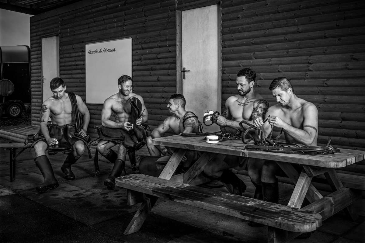 Photo of men cleaning horse tack for Hunks&Horses charity calendar, hunks & horses raise money for testicular cancer research UK and world horse welfare