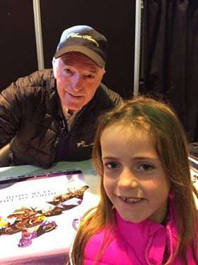 Maisie Farnham meeting John Whitaker whilst spectating at Horse Of the Year Show or HOYS