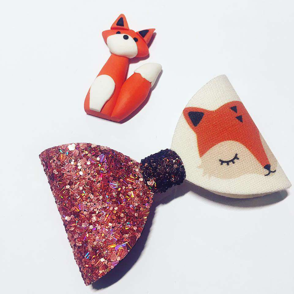 Fox Glitter hair bow from Olivia Rose boutique with brown, cream, orange and red glitter fox theme