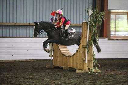 Maisie Farnham jumping on her pony Louis.