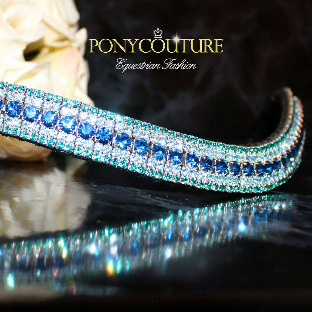 Mermaid Aqua Blue Browbands Wave Shape Bling Browbands - These beautiful blue browbands are aptly named the mermaid due to their ocean blue and turquoise shades. Handmade on wave shape bling browbands cut from Sedgwick English leather and featuring genuine Preciosa crystals this bling browband is sure to turn heads at your next dressage or showjumping event. Suited to almost all equestrian disciplines including dressur and even just happy hacking.