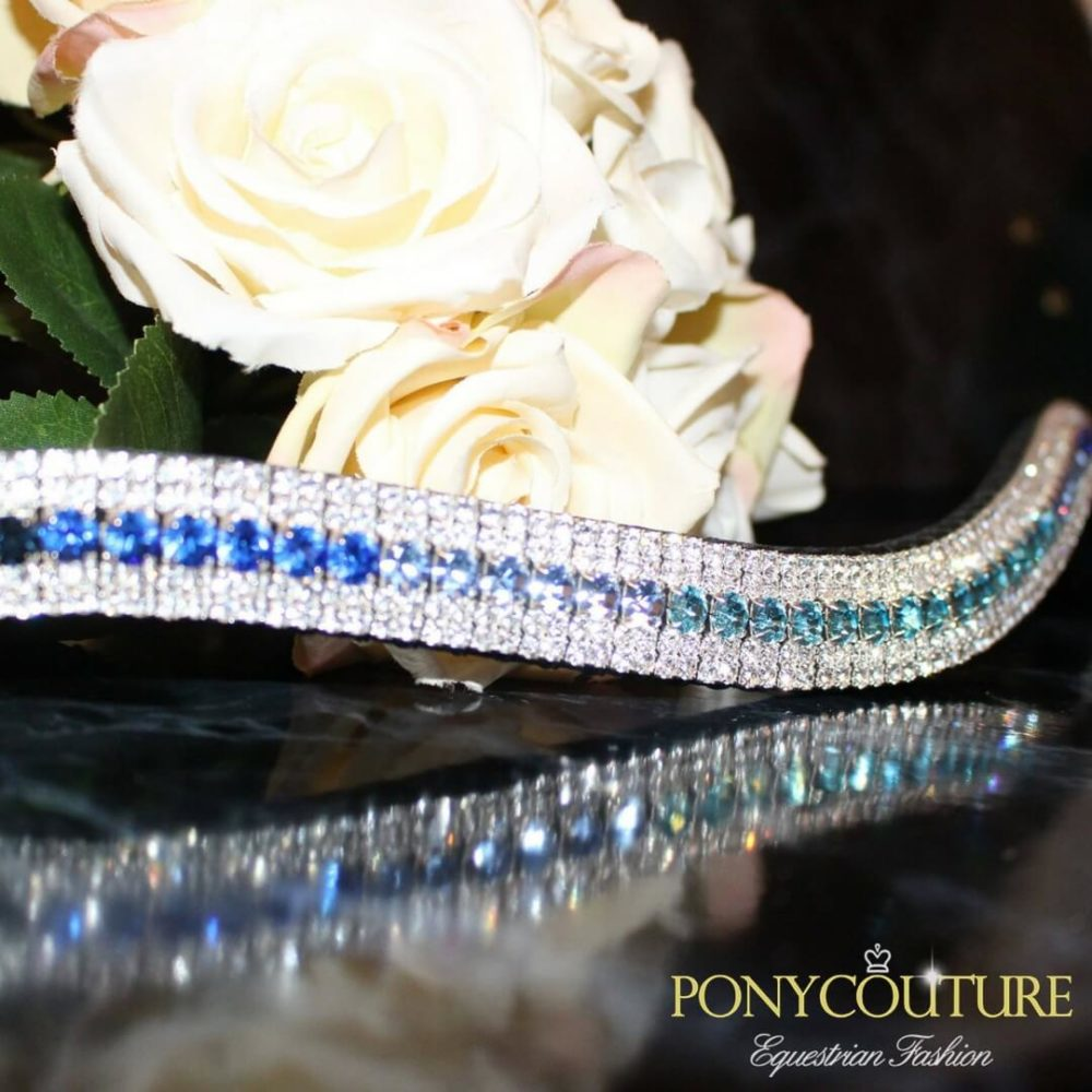 a blue ombre browband that is on sedgwick english leather and with preciosa crystals on a black marble background by ponycouture