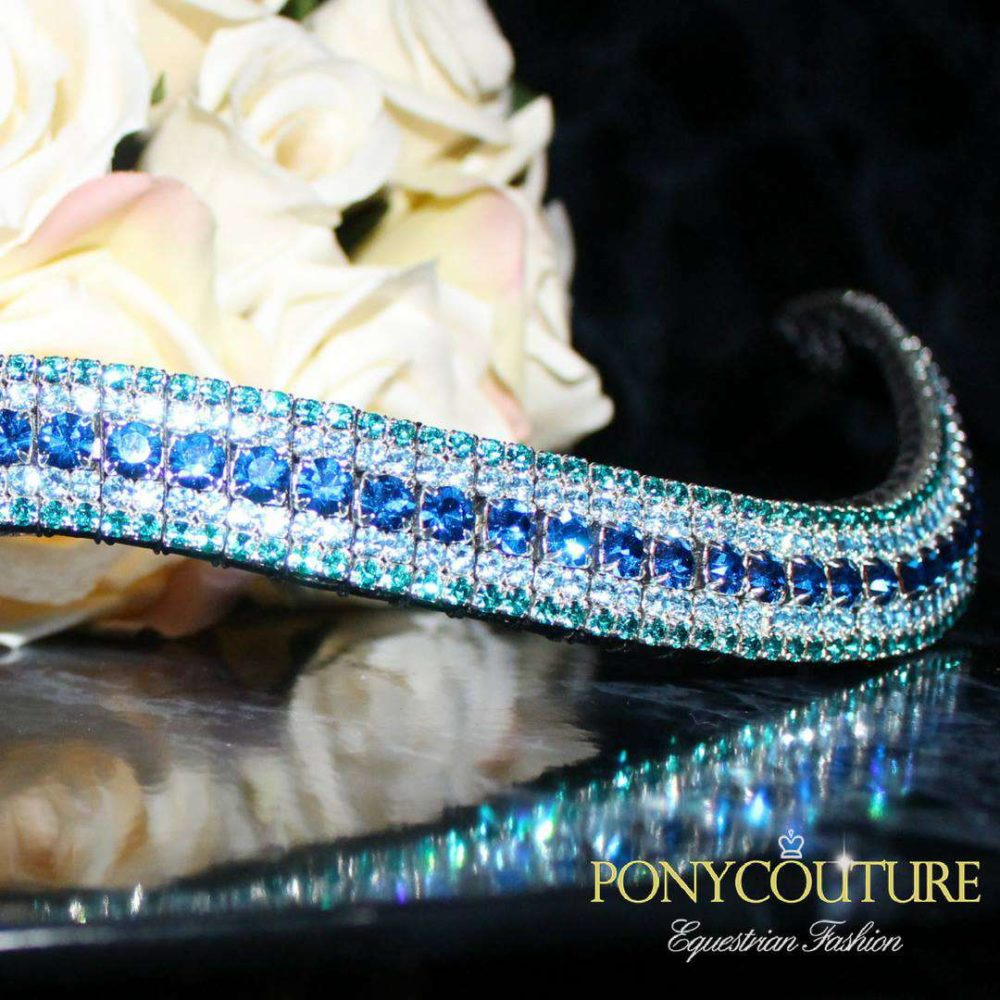 aqua blue browbands on a black back ground with blue crystals on these bling browbands