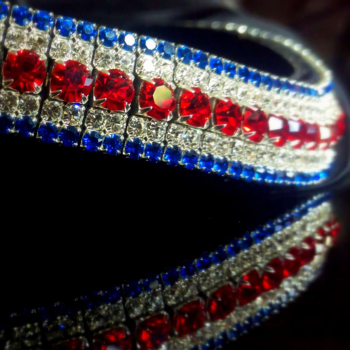Red, white and blue browband from PonyCouture's AmazBling range of bespoke, handmade crystal browbands. This bling GB browband is perfect for showing off your style in the showjumping ring, dressage arena or anything horse related. Perfect for equestrian enthusiasts.