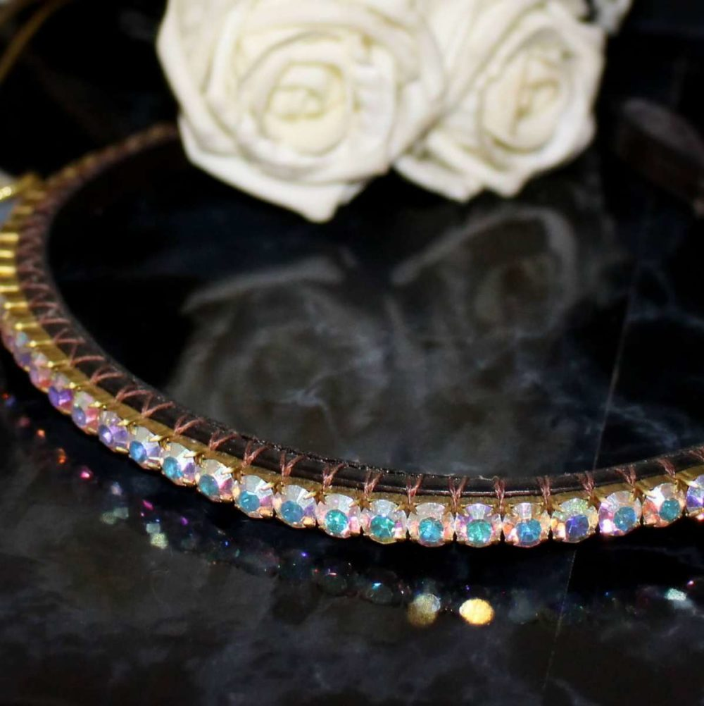 Elegant browband with iridescent preciosa crystals on a single row Pixie crystal browband with white roses in the background