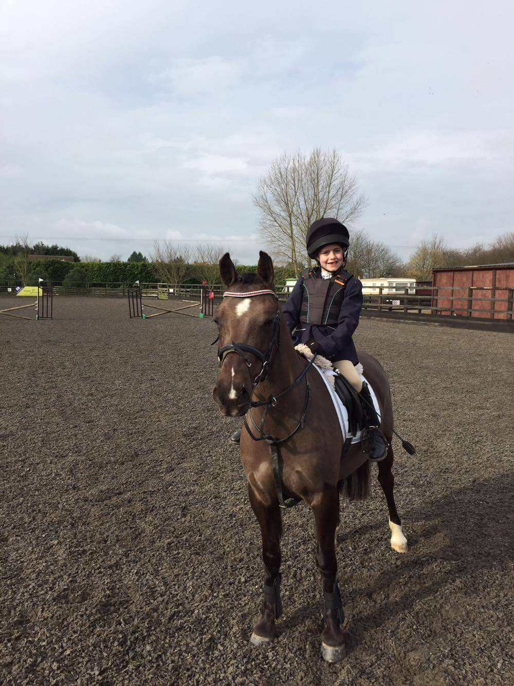 Maisie Farnham and Pony Magic sporting their luxury, handmade Crystal browband from PonyCouture's range of bespoke crystal browbands at a dressage test