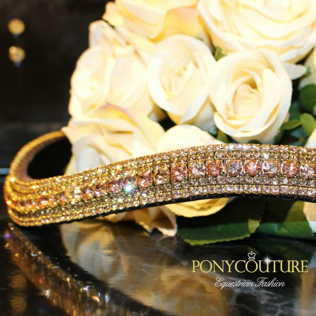 a Peach and Apricot alternating antique look browband on a black marble back ground with an antique look crystal browbands and handmade crystal browbands from ponycouture on Sedgwick English leather