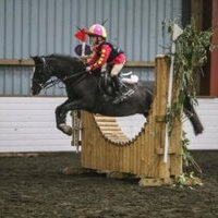 Maisie Farnham jumping on her pony Louis.