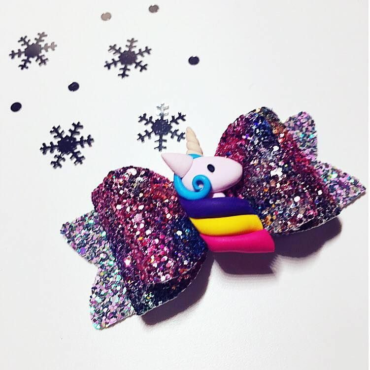 Rainbow unicorn glitter hair bows from Olivia Rose Bowtique.