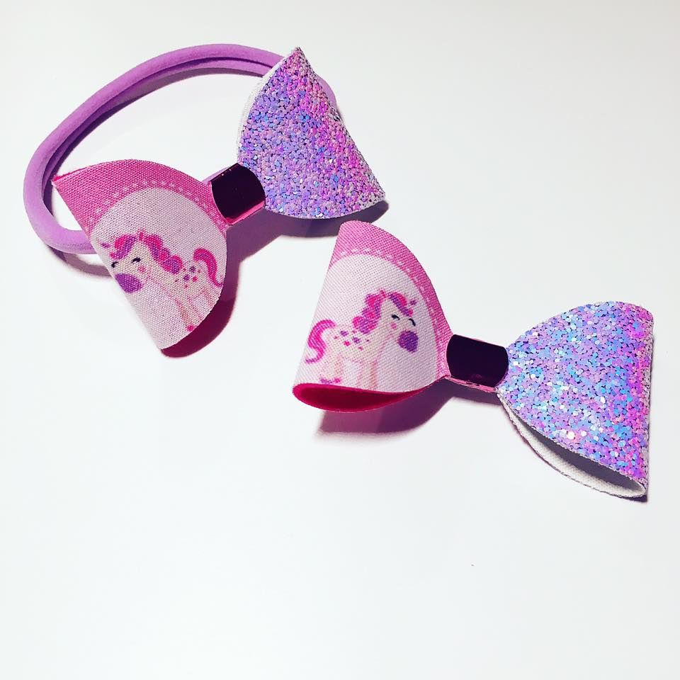 Pink and purple horse themed unicorn hair bow handmade by Olivia Rose Bowtique this glittery hair bow comes in a bobble or clip and is perfect for horse mad little girls
