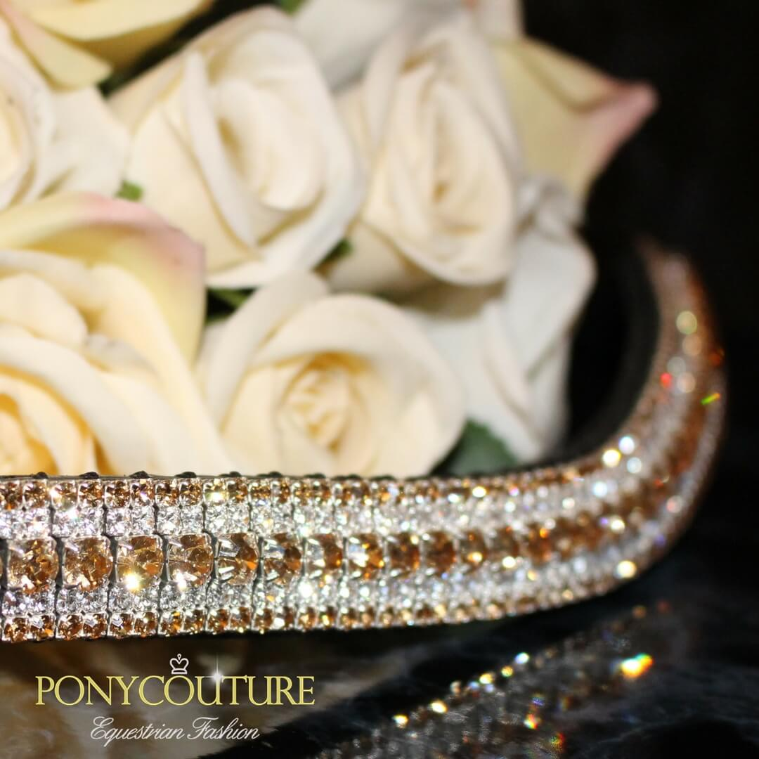 gold tone crystal browband on a black back ground with cream flowers and in five rows of preciosa crystal browbands
