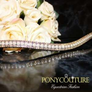 Beautiful gold and pearl browbands from our Triple Crown range of classy crystal browbands featuring pearls and light colorado crystals this beautiful bling browband is perfect for dressage, dressur, showjumping and dressage cheval