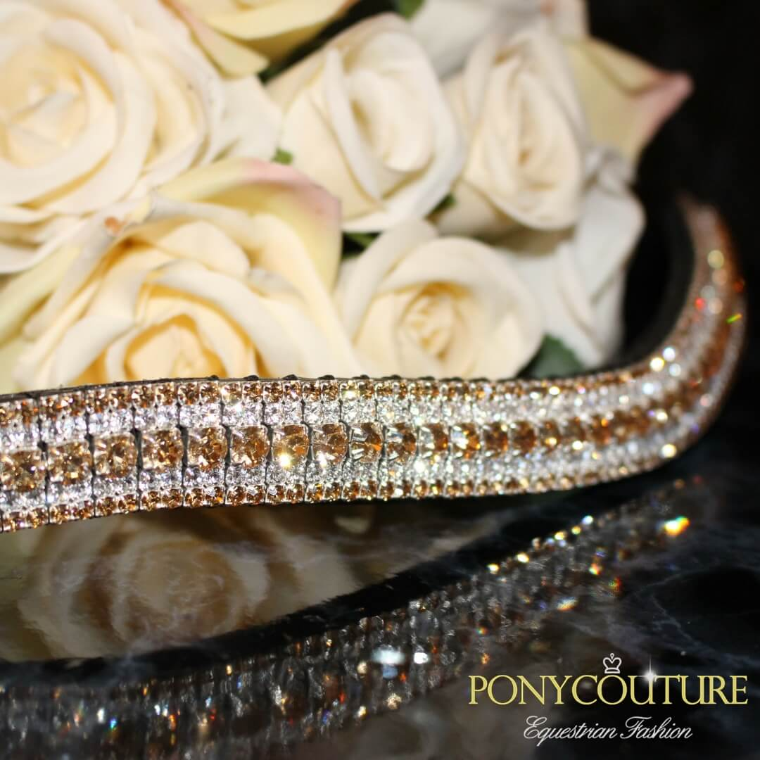 gold crystal browbands handmade browbands on a black marble back ground with flowers and in the dressage style browbands made for horses and ponies with pferd and cheval along with dressage in mind
