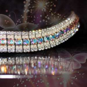 Iridescent and pearl pony size bling browband handmade on Sedgwick English leather and featuring Preciosa crystals and pearls from PonyCouture's amazBling range this stunning bling browband re-invents bling for ponies